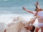 Miranda flashes her knickers during sexy Kerrtwheel on the beach