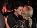 Ellie Goulding Kisses Jeremy Irvine During Brits Party