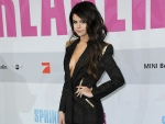 Selena shows her Breast at Spring Breakers premiere