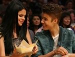 Justin Bieber is 'doting' on Selena Gomez