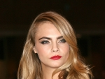 Cara Delevingne Attends Film Premiere Wearing Sultry Green Gown
