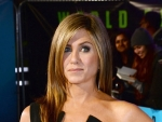 Jennifer Aniston Shows Sexy Curves in Plunging Sheath Dress
