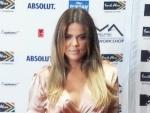 Khloe Kardashian slim legs in golden dressing after Kim Kardashian fat taunt