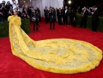 At 2015 Met Gala Rihanna in Yellow Gown Steals The Show