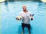 The Rock Jumps in Pool Save his Puppy