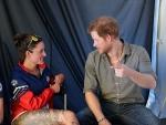 Prince Harry Kisses & Hugs Pretty Gold Medal Winning Military Hero