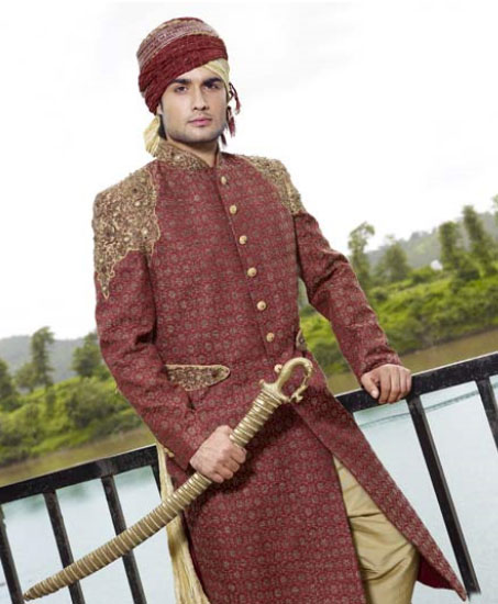 Maroon Brocade Embroidered Wedding Sherwani and swords in Hand