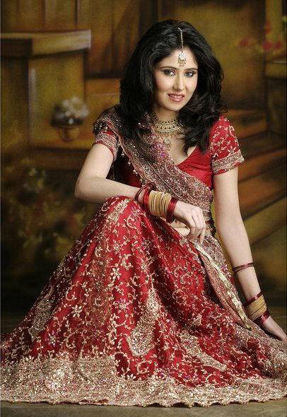 silk lehenga in red on maroon shades with heavy work
