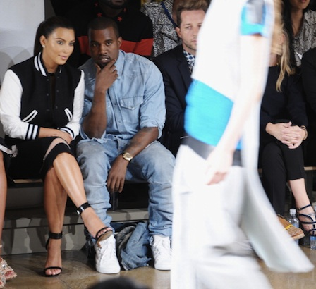 TV Personality Kim Kardashian and Rapper Kanye West attend Louise Goldin Spring 2013
