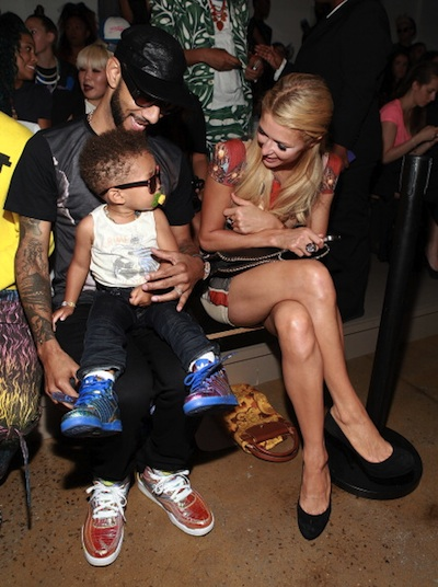Swizz Beatz with his son and Paris Hilton attend the Jeremy Scott show during Spring 2013 Mercedes-Benz Fashion Week