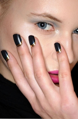 Dark golden nail polish