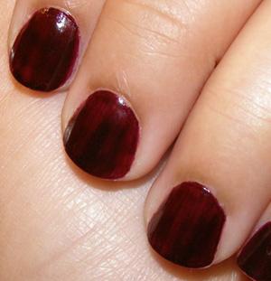 Short dark brown nail polish