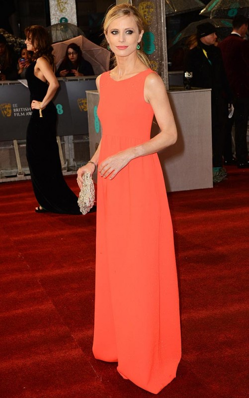 Laura Bailey clad in beautiful colour but simple gown with earrings in her ears