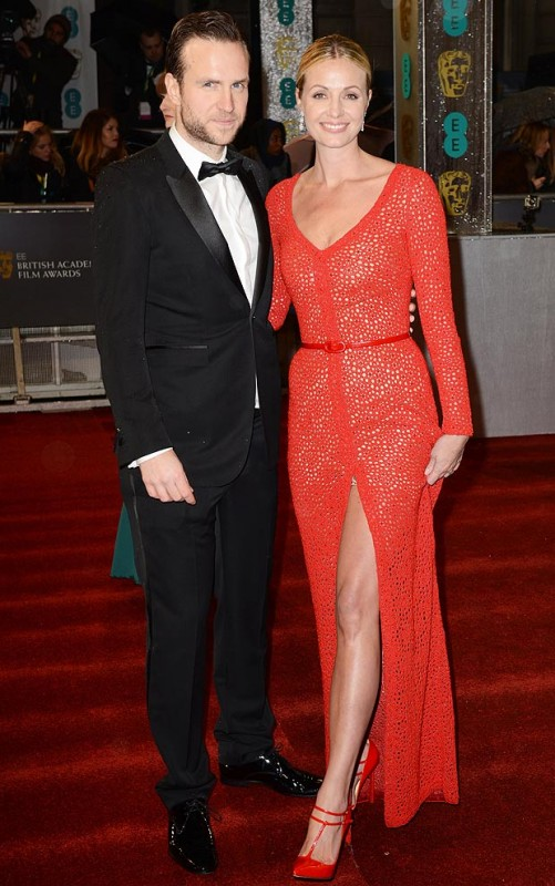 Rafe Spall is smiling beside stunning wife Elize Du Toit