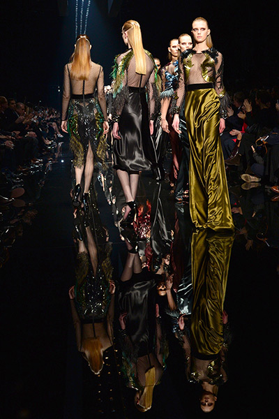 Models display creations as part of Gucci creation
