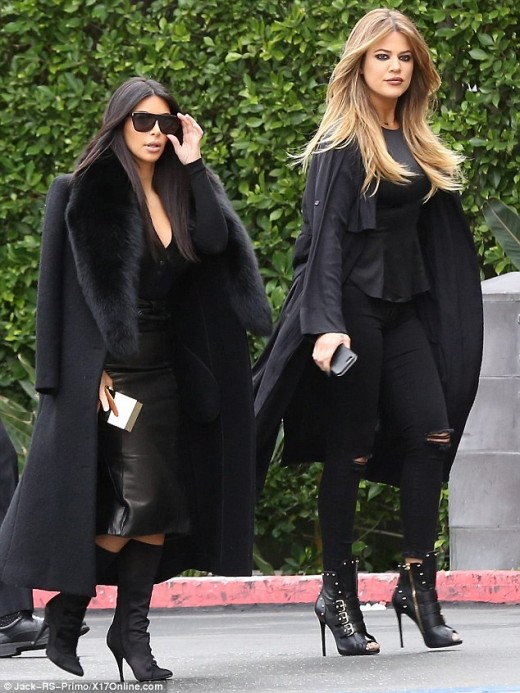 Khloe and Kim Kardashian in Black
