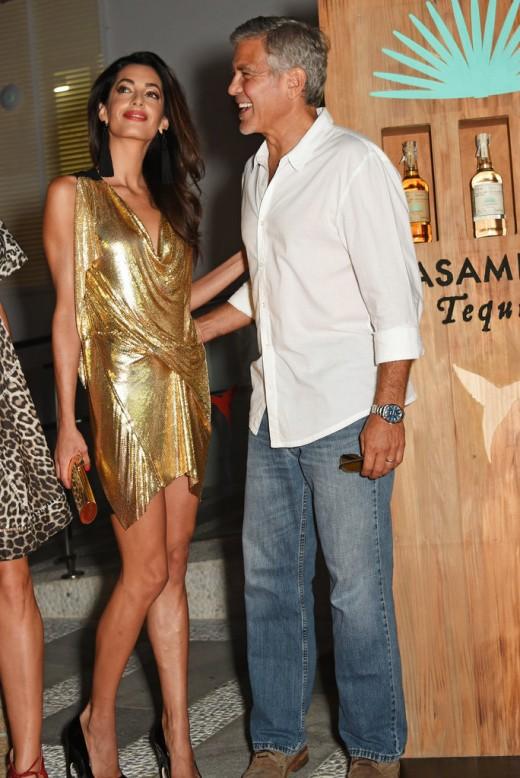 Amal-glittering-gold-minidress-stole-spotlight-when-she-stepped