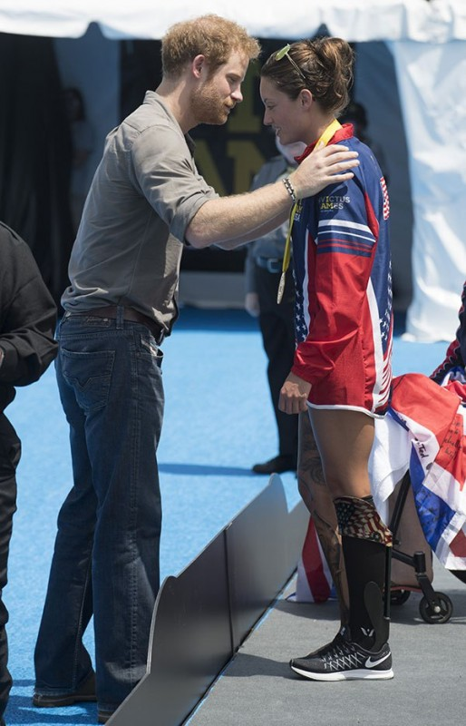 Prince Harry Kisses & Hugs Pretty Gold Medal Winning Military Hero
