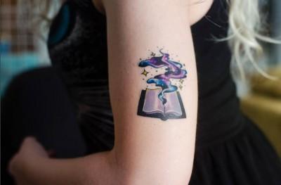 10-youreinbrookelynn-arm-book-galaxy-tattoo